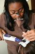 A Bauman Medical Group technician demonstrates the HairCheck hair strand analyzer.