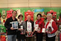 From left, Dave and Linda Dorsey, owners of Dorsey's Hallmark in Oakhurst, Steve Montalto, director of the Children's Museum of the Sierra, and H.O.L.I.D.A.Y.S. club members Carol Attwood and Toni Lagunoff.