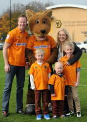 Wolves legend Jody Craddock with his family and Wolves FC mascot Wolfie (editorial director of whathouse.co.uk, Rupert Bates), copyright Sam Bagnall