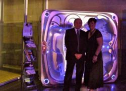 Billy and Claire from HotSpring World Peterborough with the hot tub.