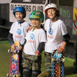 Members of SkateXS team with bamboo boards