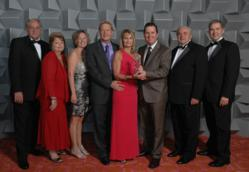 Photo of All Inclusive Outlet President Accepting Award