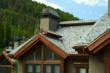 DaVinci polymer roofing tiles with blue in the color blend mixture complements this mountain setting.