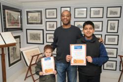Stephen Wiltshire MBE with winners Patrick and Zain.