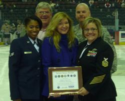 RiverKings President Robin Costa accepts the Seven Seals and Patriotic Employer Awards on behalf of Maddox Hockey.