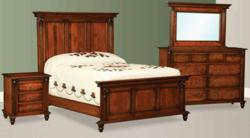 Elegance and a rich finish mark the Ellyons Bedroom Collection.