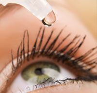 A trained professional administers drops for a patient with chronic dry eye