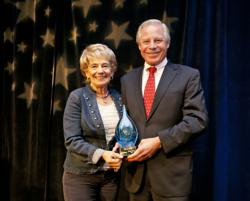 John Handerly, CHA, Senior Vice President of Handerly Hotels, Inc. presented Peggy Mosley with the CH&LA Hall of Fame award.