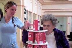 "Patient balancing cans during a ""Minute to Win It"" challenge at Whitehall Boca Raton"