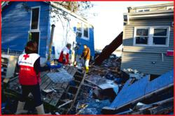 Salvaging From the Destruction-  Red Cross volunteers help residents in NY find personal items amidst the devastation from Hurricane Sandy. (Photo: Talia Frenkel/American Red Cross November 6, 2012.)