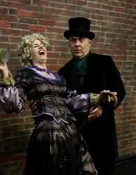 Kittson O'Neill and Paul L.Nolanas Mrs. Bob Cratchit and Ebeneezer Scrooge in MRS.BOB CRATCHIT's WILD CHRISTMAS BINGE.
