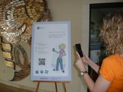 Karen Kofsky at Temple Beth Emet in Cooper City, FL tries out the new QR Code mobile donation feature