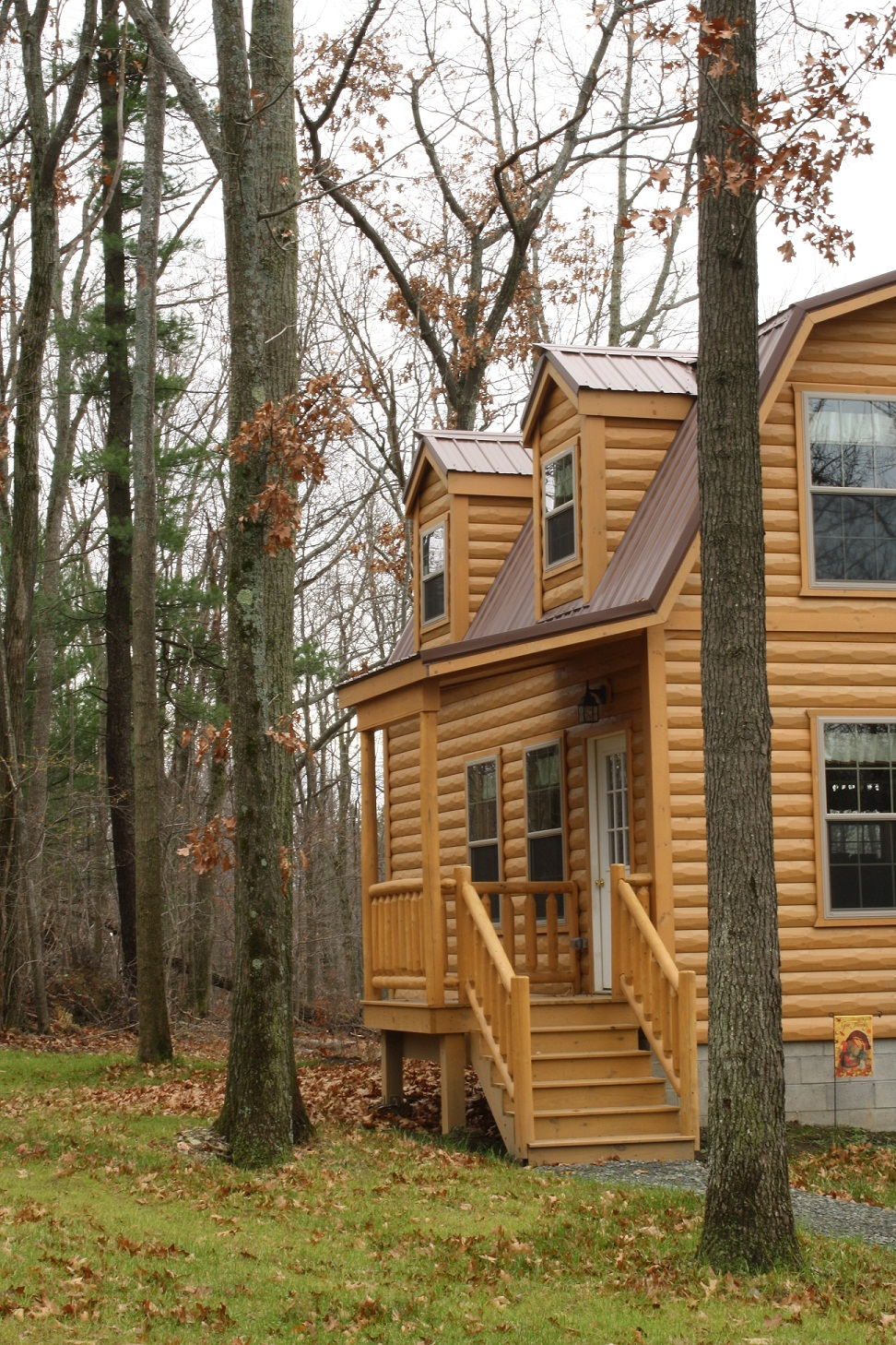 Wood tex products introduces certified modular homes to for Wood cabin homes