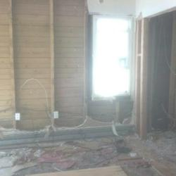 Vinny has started demolition to prevent mold from growing, ripping the walls and floors to the studs.