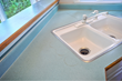 Stained and dated laminate Countertop before