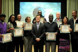 Social Reform Director of the Church of Scientology National Affairs Office in Washington, D.C., Jesse Morrow (center front) presented each seminar attendee with a drug prevention certificate.