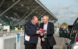 Jim Betchley (left) welcomes his first customer to I Love meet and greet at Stansted