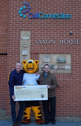 Paul Morris from the Town 102 Kids Trust receives the cheque from Andrew Goulborn of Tiger.co.uk