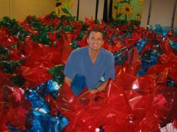 Rod Khleif surrounded by food baskets for needy Sarasota Families