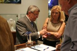 Pieter Andries shows jewelry design to Bob Jones President Debra Edmondson and Southlake Parks President John Slocum