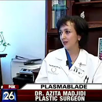 Dr. Azita Madjidi speaking to a FOX News Reporter while sitting at her desk.