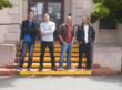 Four actors on the courthouse steps to protest their ticket for being seen by a video cam going through a red light.