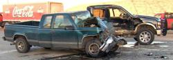 Austin car accident attorney Carl Barry is suing for the wrongful death of a man in the accident pictured above. Two pickup trucks are badly damaged.