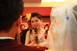 Hellen Chen helps a couple tie the knot