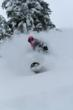 A snowboarder enjoys the deep snow at Stevens Pass Mountain Resort.