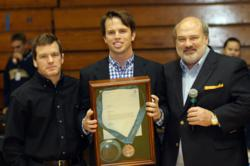 Olympian Terry Brands is seen here with Will Jones and Allan Jones on Nov. 16 during a ceremony held to commemorate the passing of an Olympic medal to a younger generation.