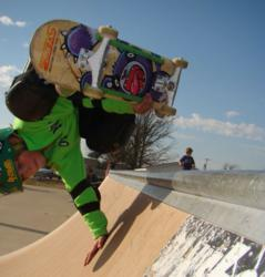 Young Skateboarder doing handplant