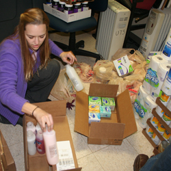 Heather Rutherford, a Master of Divinity student at United Theological Seminary, loads items to take to West Virginia.