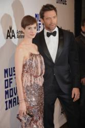 "Anne Hathaway (L) carries the Jill Milan Art Deco clutch as she and ""Les Miserables"" co-star Hugh Jackman attend the Museum Of Moving Image Salute To Hugh Jackman, December 11, 2012 in New York. (Photo by Gary Gershoff / WireImage)"