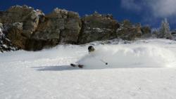 Alta skier on a big powder day