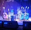 A rockin' stage set - 7 guitars, plenty of amps, great guitarin'...