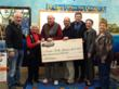SMRi's $50,000 check will help Sturgis-area non-profits during the holiday season an as 2013 begins