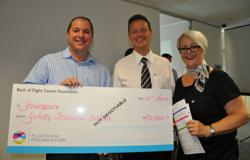 David Conry from Youngcare holding the cheque with Flight Centre's Michael Murphy and Robyn Blacklock