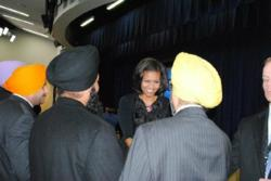 Picture by Sonia Bhagat: Mitchelle Obama Shaking hands with Dr. Rajwant Singh, standing next are Raghuvinder Singh (Son of Baba Punjab Singh), Gurmail Singh (Son of Baba Santokh Singh)