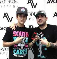 Avodroc's Oscar Cordova (right) poses with teen pop star Austin Mahone and the custom red-diamond iPhone he built for him. On December 15, Cordova's company will be offering the same services to customer's nationwide through its Mod-by-Mail program.