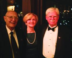 Jim Corliss, owner of Braintree Printing, right, attended the annual celebration of Winston Churchill's birthday at the Union Club in Boston with Ralph Wilbur, owner of Graphic Litho, and Kathleen Corliss.