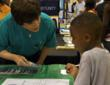 A volunteer at a Truth About Drugs booth in Nashville, Tennessee, helps a young boy make the decision to live drug-free.