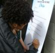 People of all ages sign the drug-free pledge at booths set up by Scientologists at Nashville farmers market.