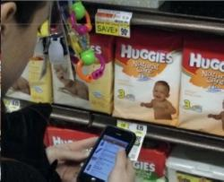 MobiSave beta tester using the app to save money while she shops.
