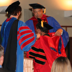 A Doctor of Ministry graduate participates in United Theological Seminary's Advent Commencement.