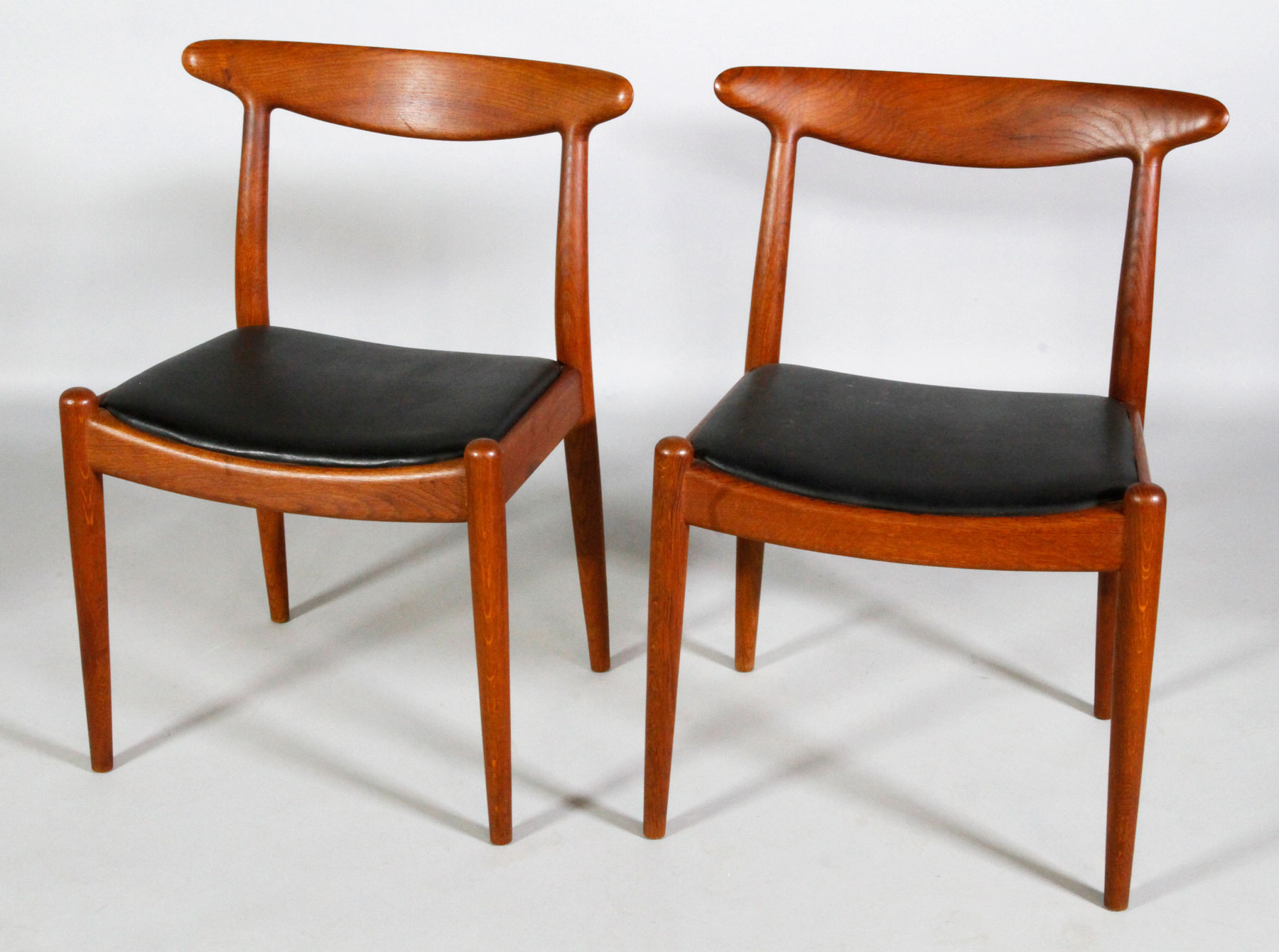 Pair Of Hans Wegner Side Chairs, Oak With Black Leather Seats, Early 1960s,  Each With Branded Mark Under Seat, C. M. Madsens Fabriken, Haarby Danmark,  ...