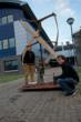 Benjamin Vogelli pictured with his Research Supervisor Dr Alasdair Macleod with one of the Wind Turbine prototypes he developed during his time at Lews Castle College UHI.