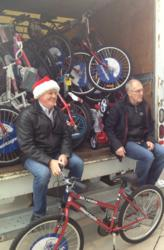 Life Science Nutritionals Founder and CEO Stuart Lowther delivering bikes with Greg Pace