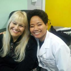 Dr. Emily Letran with a satisfied patient