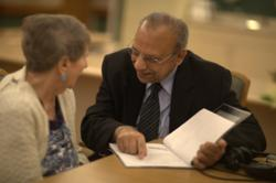 Dr. Govind Bharwani consulting with a resident