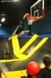 Slam dunk basketball on the trampoline is a huge hit with kids.